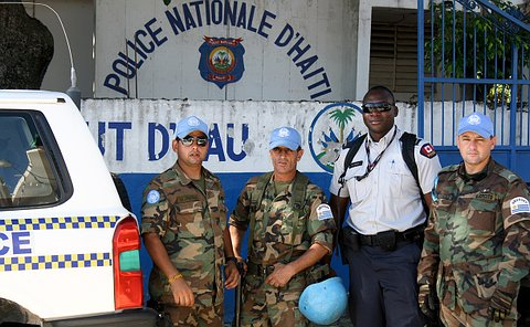 A Toronto Police officer in Haitian uniform with three officers in UN Uruguay police uniforms