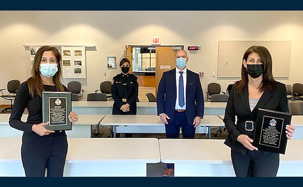 Four people standing apart with masks