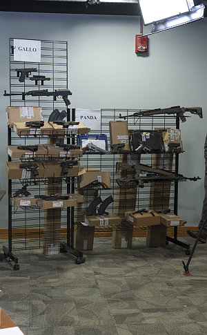 Two racks with handguns and rifles