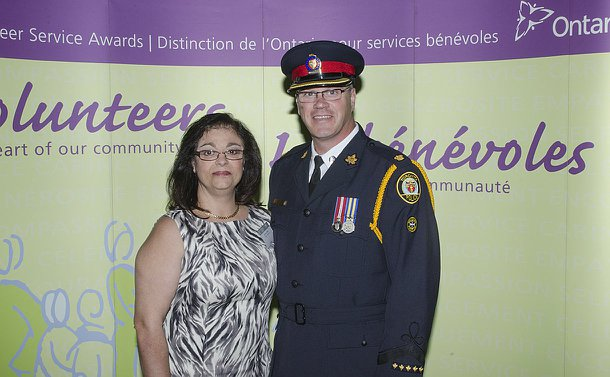 A woman and a man in TPS uniform against a photo backdrop