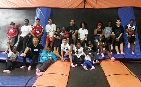A group of students and adults at a trampoline park