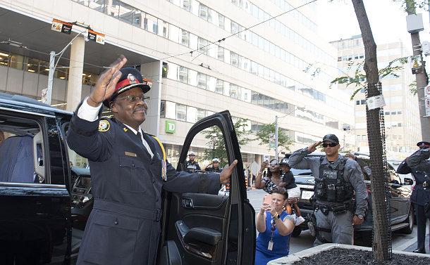 A man in TPS uniform waving