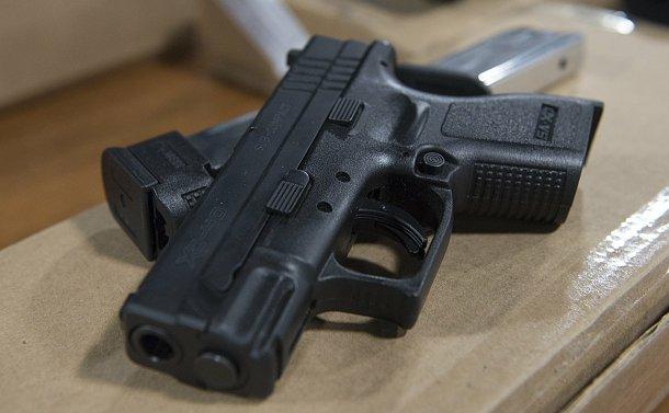 A small black handgun