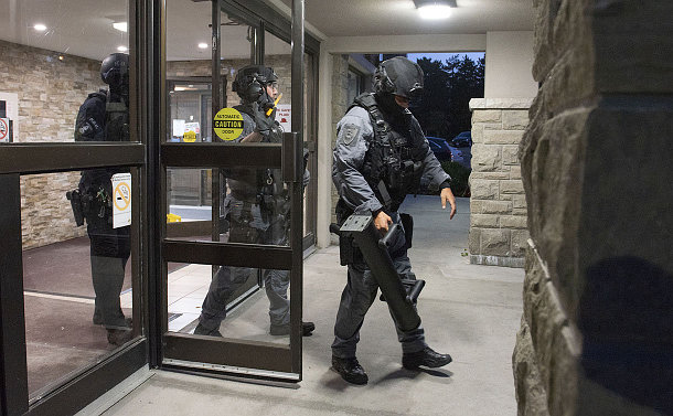 A group of people in tactical police gear