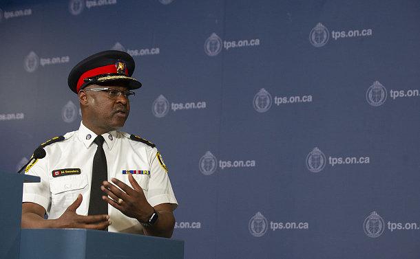 a man in TPS uniform at a podium