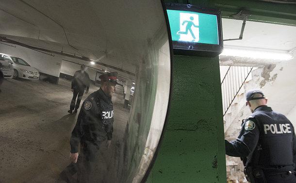 Men in police uniform going through a doorway