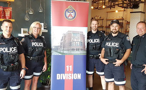 A group of people in TPS uniform with an 11 Division sign