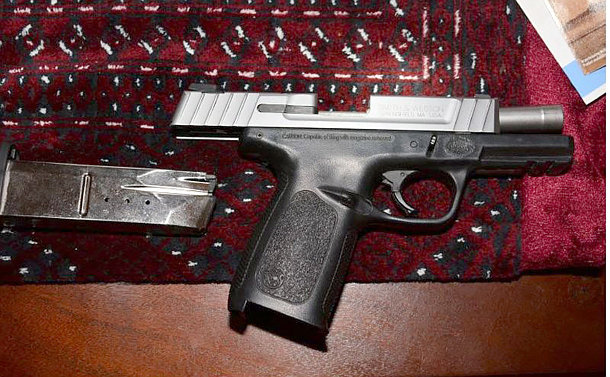A handgun and clip on a table