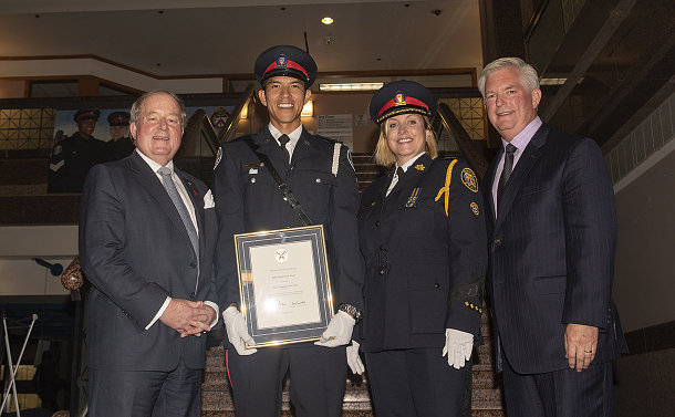 Two men and one woman and another man in TPS uniform