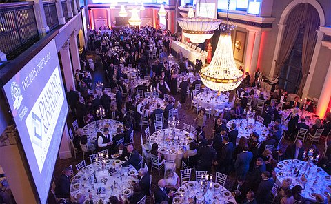 A banquet hall filled with tables and people
