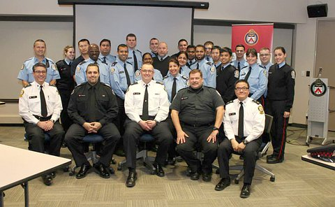 A large group of men and women in TPS uniform
