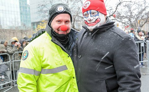 A man in TPS uniform with a red nose and a clown