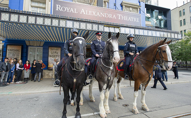 Officers in uniform on horseback