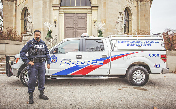 A man in TPS uniform with a TPS truck