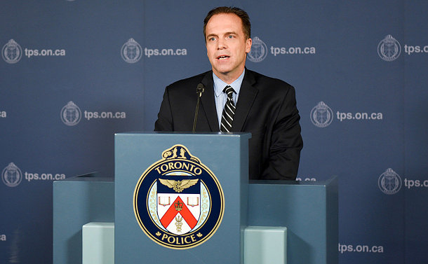 A man stands a podium with a TPS logo