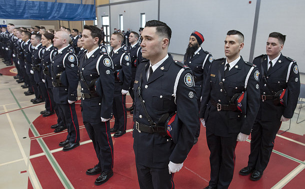 Men and uniform lined up in TPS uniform