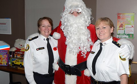 Kathryn Martin from 42 Division and Bernadette Button from 43 Division, with the Santa Clause