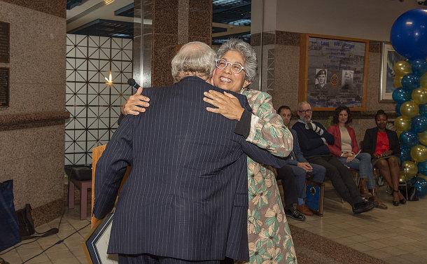 A man hugs a woman