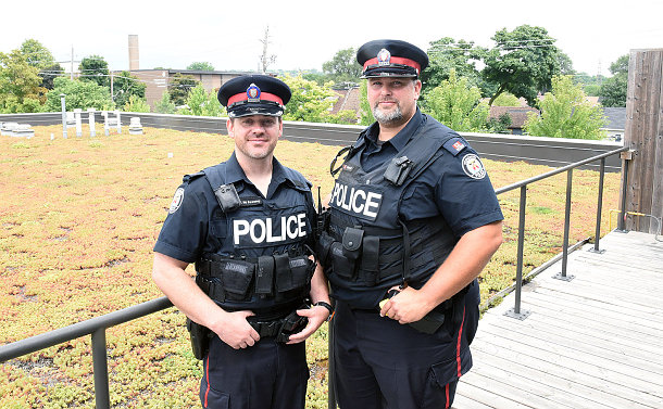 Two men in TPS uniform