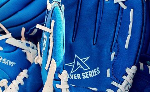 A pile of blue baseball gloves