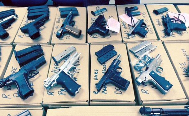 Handguns laid across a table