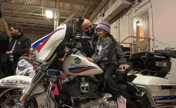A man with a girl on a motorcycle