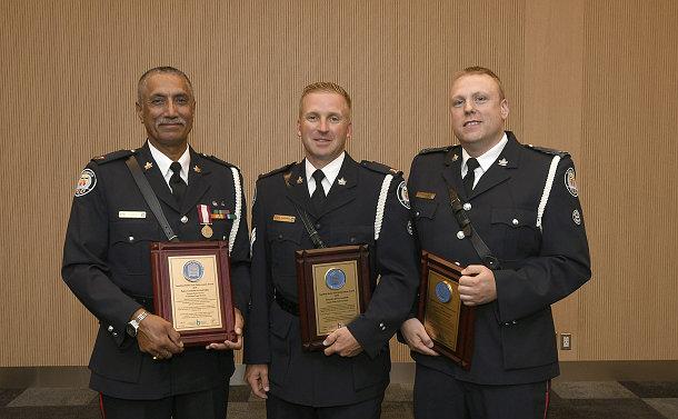 Three men in TPS uniform