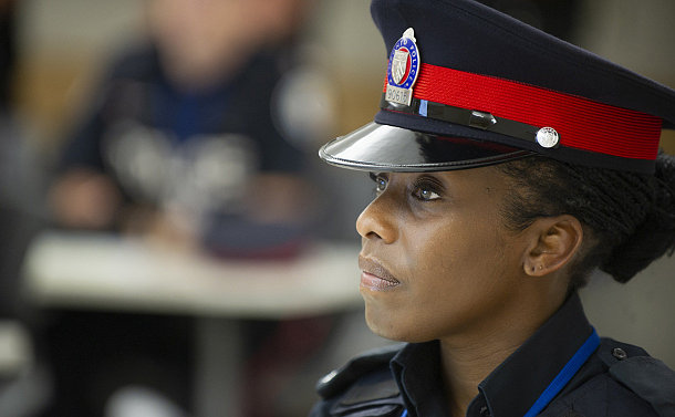 Close up of a woman wearing a police heat and uniform