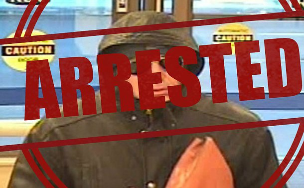 A man in a hooded jacket with the word arrested over the image