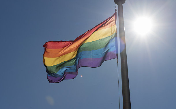 A rainbow flag in wind